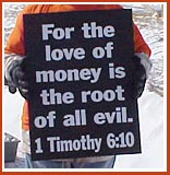 Sign from 11 March 09 Thorp Dog Auction protest: For the Love of Money is the Root of all Evil.