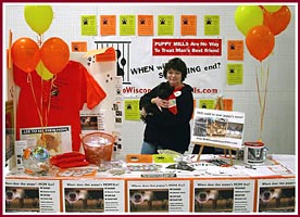 Volunteers set up and manned a booth at the Oshkosh Pet Expo in April 2008 to let people know about puppy mills.